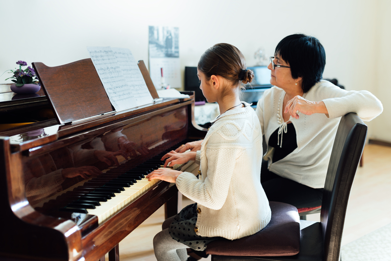 A piano lesson - student and teacher