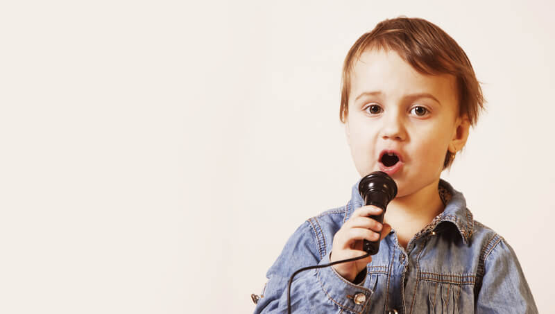Little boy singing with mic